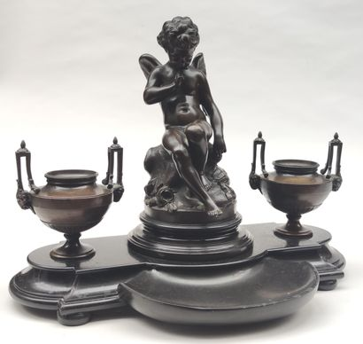 INK in black marble and bronze with a motif...