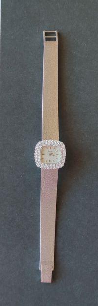 Montre bracelet de dame en or gris, La lunette...