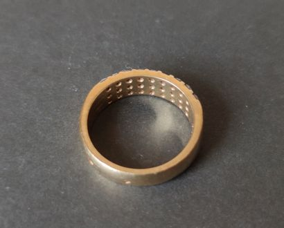RING 750°/°° yellow gold ring set with nine lines of three small cut diamonds, Gross...