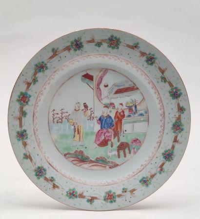 PLATE in polychrome enamelled porcelain...