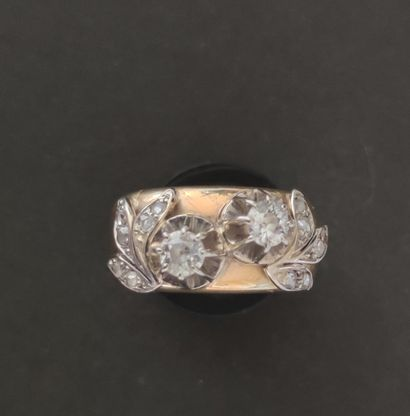 RING in yellow gold 750°/°°° decorated with two cut diamonds accosted by foliage...