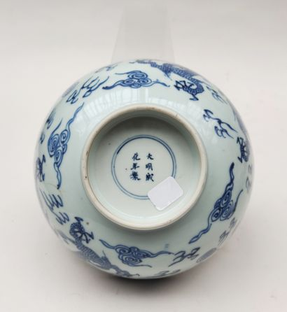Large porcelain bowl with blue dragon camaieu...
