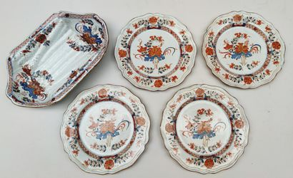 Set of one asparagus dish and four plates...