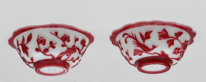 Pair of red PEKIN glass CUTTERS on a milky...