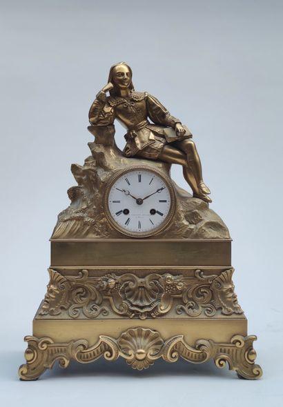 PENDULE en bronze doré à motif d'un jeune...