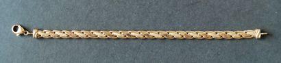 Bracelet en or jaune 750°/00 à maille tréssée,...