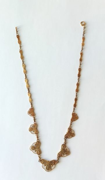 """NECKLACE """"drapery"""" in yellow gold 750°/°° with seven openwork elements in the form..."""