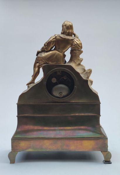 PENDULE en bronze doré à motif d'un jeune Homme assis, travail du XIXe siècle
