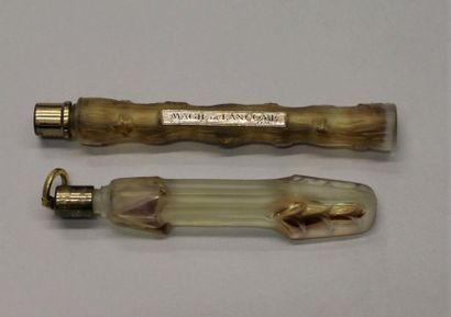 Lancôme - (années 1950)  Deux flacons de sac en verre incolore dépoli pressé moulé...