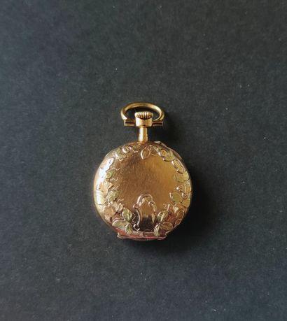 MONTRE pendentif de Dame en or jaune 750°/°° , mouvement mécanique Poids brut :...