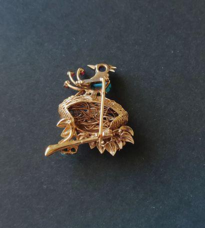 BROCHE en or jaune 750°/°° et diverses pierres de couleurs en cabochons et perles...