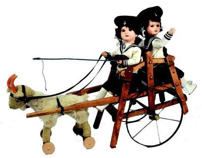Charrette en bois avec roues métal attelée...
