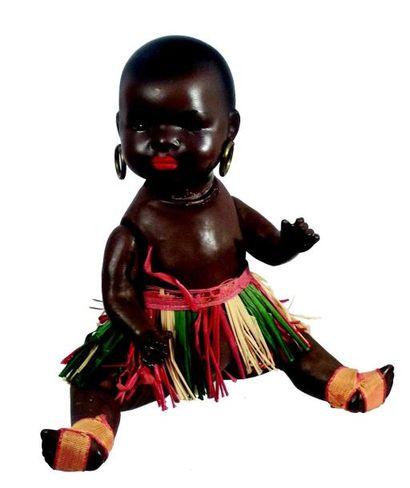 Petit bébé caractère noir de fabrication...