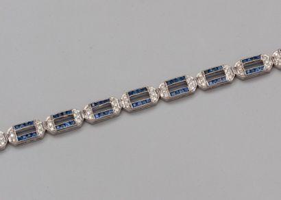 Bracelet articulé en or gris 750°/00 (hibou)...