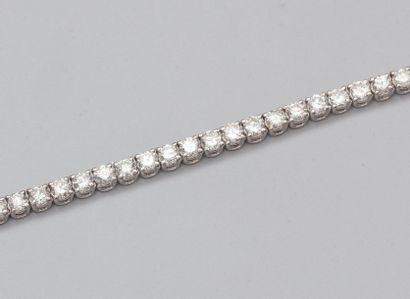 Bracelet rivière en or gris 750°/00 (hibou) serti de diamants taille brillant en...