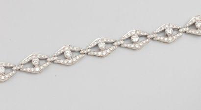 Bracelet souple en or deux tons 750°/00 (hibou),...