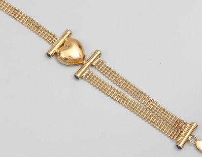 Bracelet en or jaune 750°/00, orné d'un coeur,...