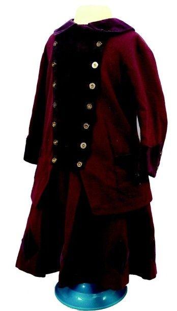 Jolie robe d'hiver de petite fille en lainage...