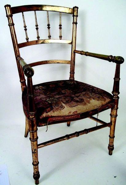 Très beau fauteuil d'enfant en bois doré avec assise cannée. H 65 cm (XIXème) Nice...