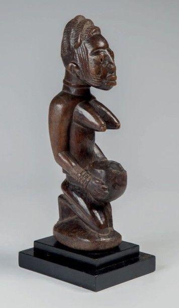 Yoruba, Nigéria. Statue «Aguéré Ifa» porteuse...