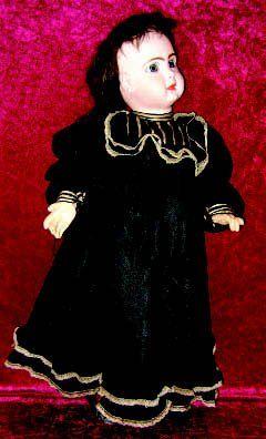 Robe noire en soie brochée, manches à gigot,...