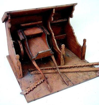 Ecurie en bois avec charrette, coins de décor...