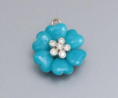 Pendentif fleur en or jaune 750°/00 serti de diamants , les pétale de pierre bleue...