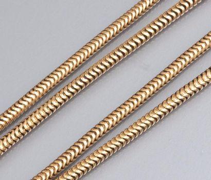 Collier en or jaune 750°/00 (tête d 'aigle), maille serpent. 33.60 g. L : 62 cm