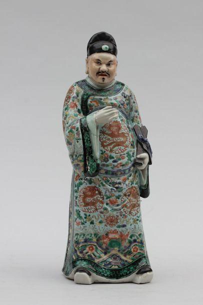 Statuette de dignitaire en porcelaine.CHINE...