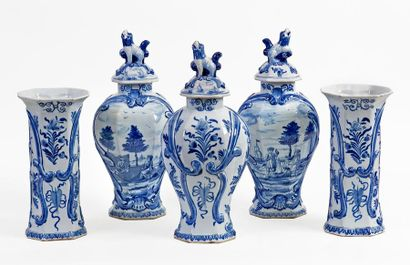 Delft blue and white earthenware set comprising a series of three covered pots and...