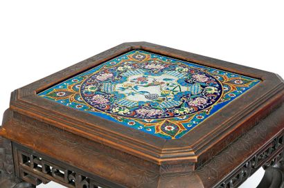 Square pedestal table with carved and openwork corners in Chinese taste Curved legs...