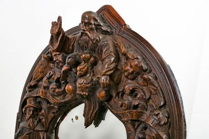 Renaissance style carved walnut carved oval mirror decorated in high relief with...