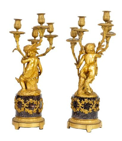 Pair of large Louis XVI style candelabra in red porphyry and chased and gilded bronze...