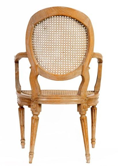 Pair of Louis XVI style caned cabriolets armchairs in carved and moulded natural...