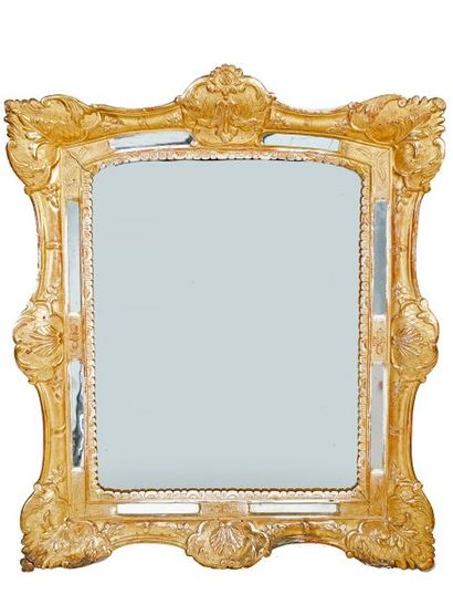 Regency style beaded mirror in carved and gilded wood French work, early 18th century...