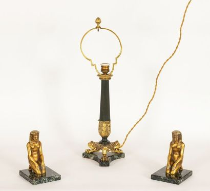 Pair of gilt bronze and green marble bookends in Empire style decorated with a kneeling...