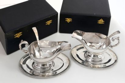 Pair of one-handled sauce boats, their display and spoon in 950 Sterling Silver...