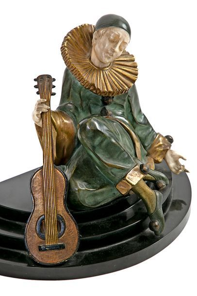 Alfred GILBERT (1864-1934) A seated Pierrot with a Bronze mandolin with green, brown,...