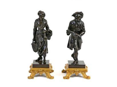 Couple revenant du marché Paire de sculptures...