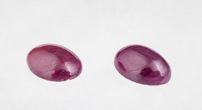 Set of two opaque ruby cabochons in red violet...