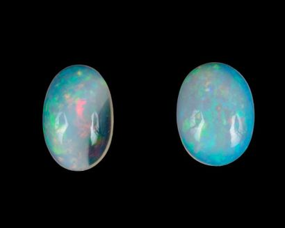 Batch of 2 translucent to opaque white opals...