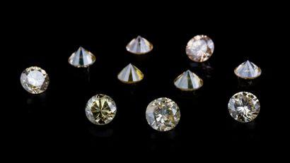 Lot of ten round diamonds totalling 0.83 ct. of pale yellow to intense yellow through...