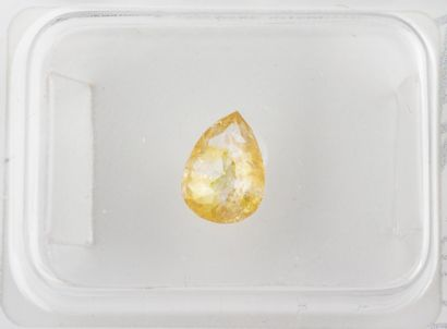 Natural Fancy Orangy Yellow diamond in pear cut of 0,60 ct. with many inclusions...