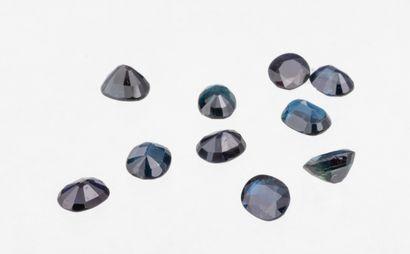Set of ten very dark blue oval sapphires...