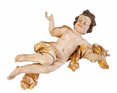 Angelot en bois polychrome sculpté représenté volant les bras écartés. Travail du...