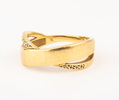 Bague en or jaune 18k (750 millièmes) figurant...