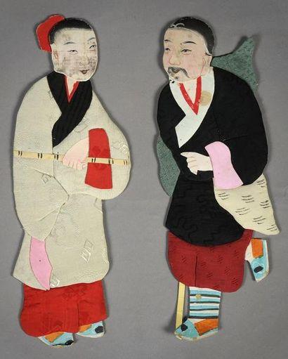 Deux personnages en carton peint et soie....