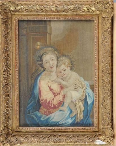 TABLEAU en tapisserie représentant une Vierge...