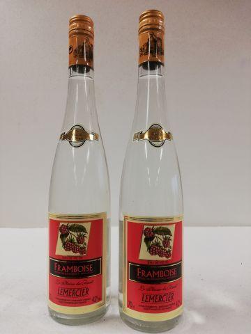 2 bouteilles de Liqueur. Eau de Vie de framboise....