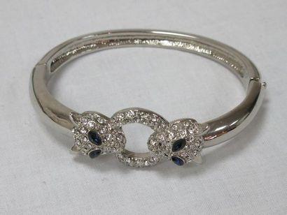 Bracelet jonc en métal argenté strassé, orné...